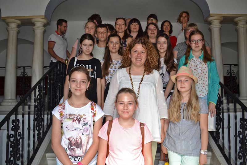 Anna Peszko pictured with Polish exchange students in Ronda City Hall