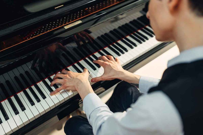 pianist-playing-music-on-grand-piano