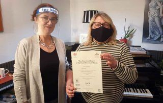 Anna presenting ABRSM Certificate to Yvonne