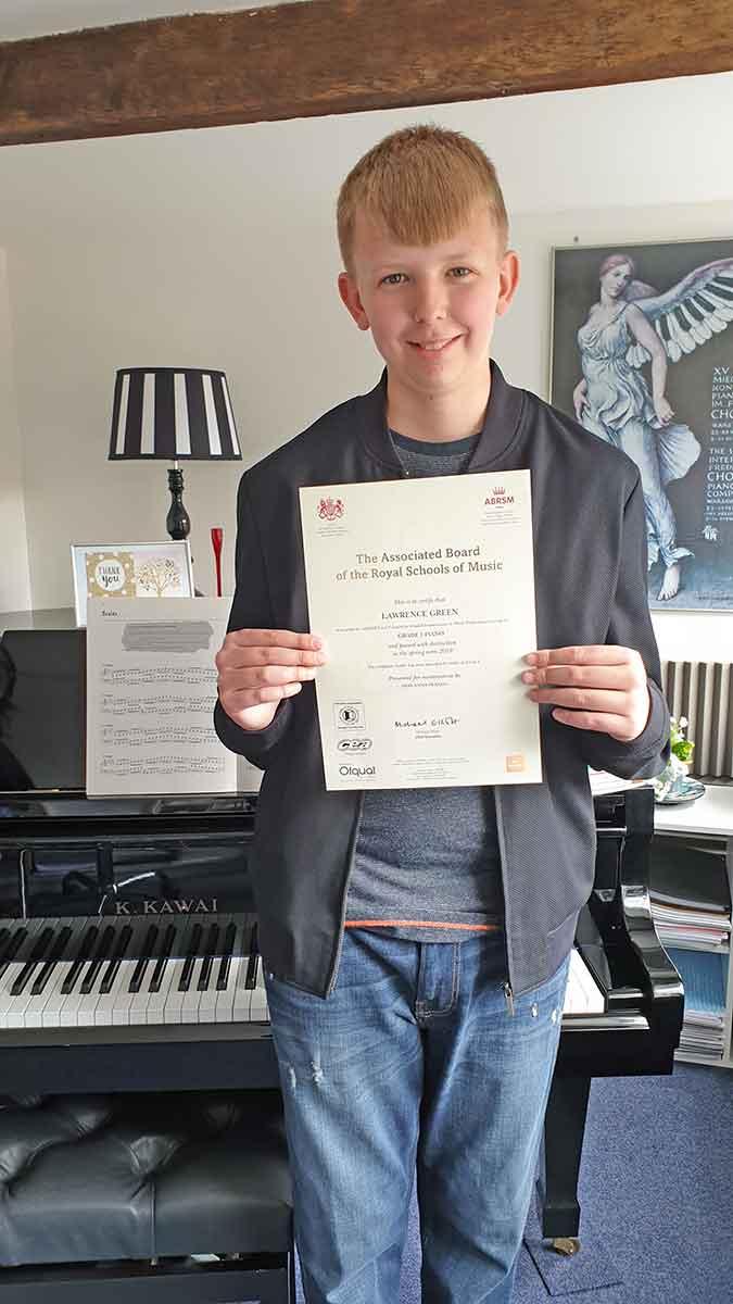 Lawrie with ABRSM distinction certificate