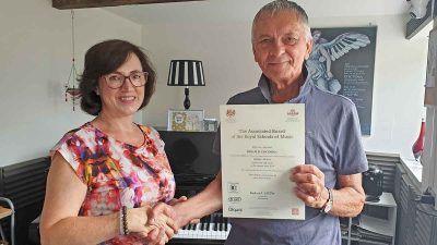 Anna Peszko presenting ABRSM merit certificate