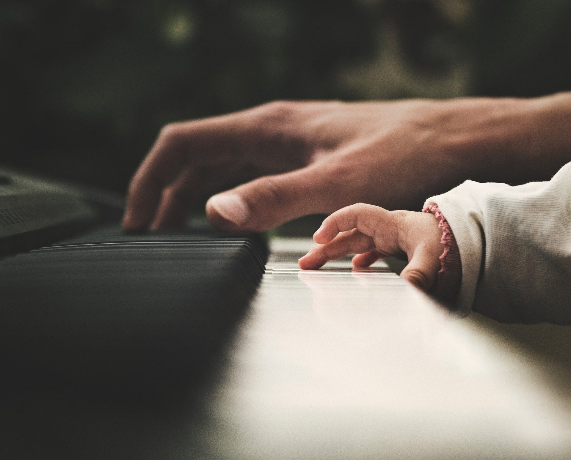 Parent and child at the piano